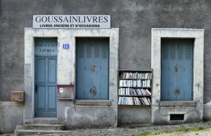 Free books are displayed outside a bookstore in Goussainville-Vieux Pays, north of Paris